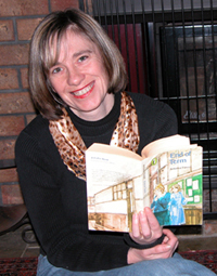 Colour photograph of Liz Filleul, reading Antonia Forest's End of Term